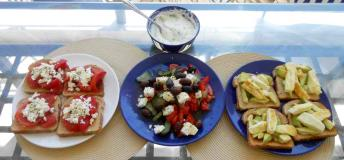 Tzatziki(top center) is a staple in greek cuisine and can be complimented with different dishes. Grab local ingredients throughout the islands and create this quick yet delicious meals.