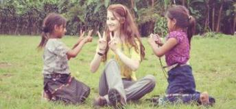 A volunteer plays with two Guatemalan girls