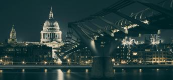 Bridge across the Thames River at night