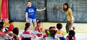 A volunteer teaching English to children