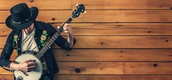 Man holding a bandurya guitar