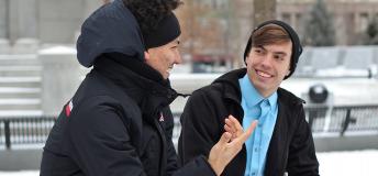 Male friends talking in a snowy park