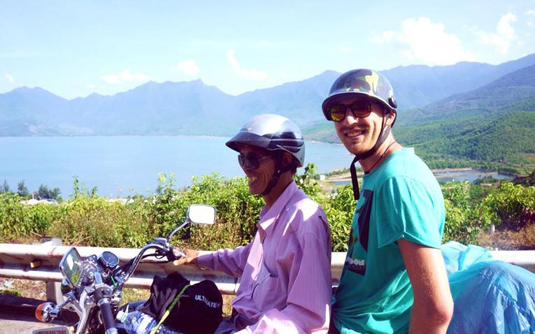 Riding a motorbike on Hai Van Pass in Vietnam