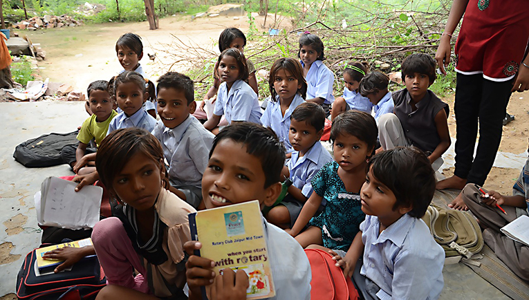 Indian school children sitting outside