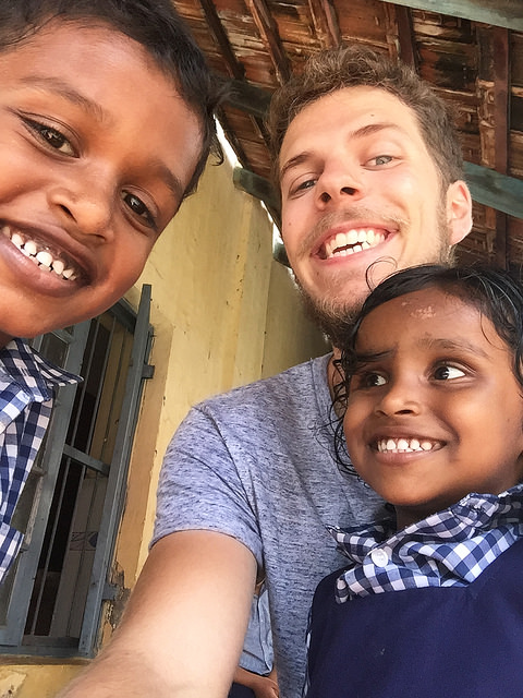 Volunteer with kids at a local school in India