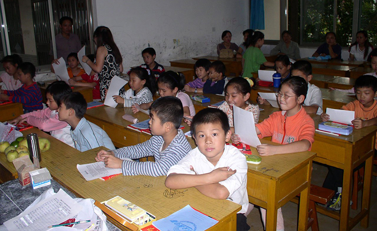 Classroom full of children sitting at their desks working