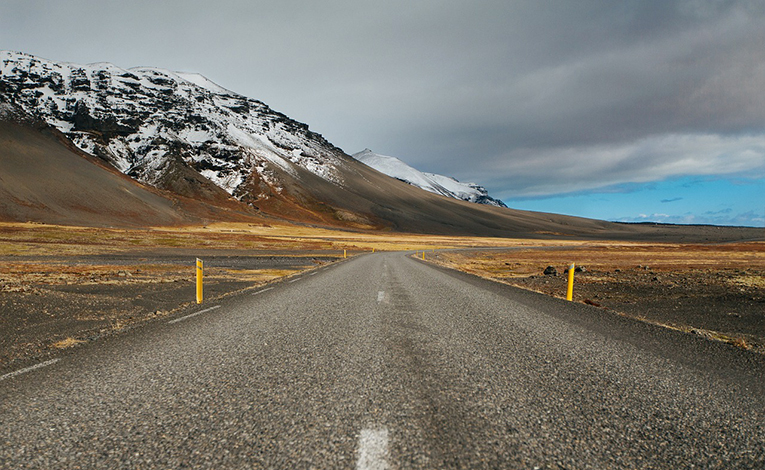Road next to snow covered mountains