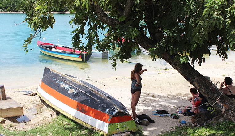 Boats along a beach in the Caribbean