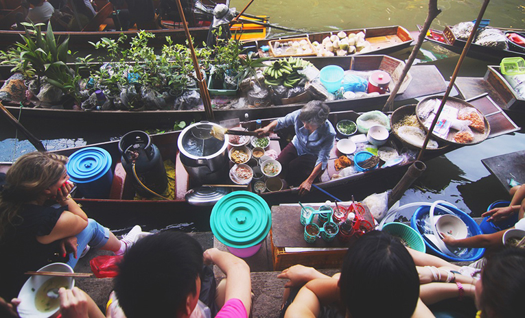Floating market vendors in Thailand